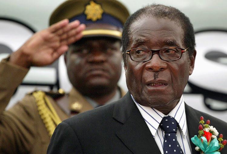 FILE PHOTO: Zimbabwe President Robert Mugabe attends the launch of basic commodities in Harare, Zimbabwe July 16, 2008. REUTERS/Philimon Bulawayo/File Photo