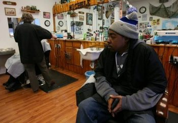 Victor Burch, 40, waits for customers in his barber shop in Livonia, Michigan, U.S. January 24, 2020. Picture taken January 24, 2020. REUTERS/Michael Martina