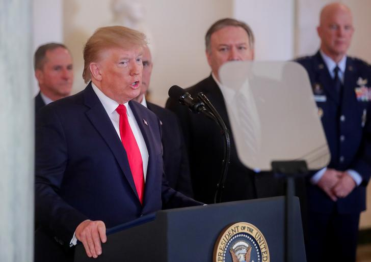 U.S. President Donald Trump is flanked by Secretary of State Mike Pompeo as he delivers a statement after Iran launched missile attacks on U.S.-led forces in Iraq, in the Grand Foyer at the White House in Washington, U.S., January 8, 2020. REUTERS/Jonathan Ernst