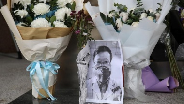 A makeshift memorial for Li Wenliang, a doctor who issued an early warning about the coronavirus outbreak before it was officially recognized, is seen after Li died of the virus, at an entrance to the Central Hospital of Wuhan in Hubei province, China February 7, 2020. REUTERS/Stringer
