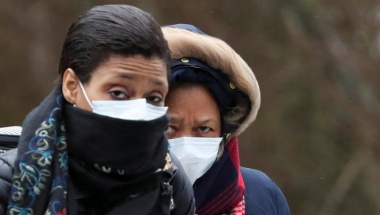 Women wearing masks leave a Creil's hospital, where people tested positive for coronavirus have been treated, France, February 27, 2020. REUTERS/Yves Herman