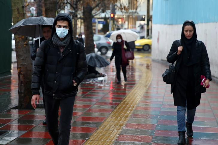 An Iranian man wears protective mask to prevent contracting coronavirus, as he walks in the street in Tehran, Iran February 25, 2020. WANA (West Asia News Agency)/Nazanin Tabatabaee via REUTERS ATTENTION EDITORS - THIS IMAGE HAS BEEN SUPPLIED BY A THIRD PARTY.