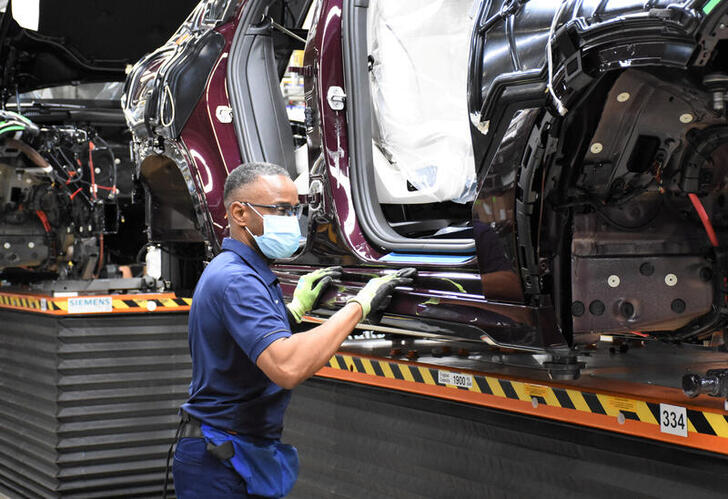 A BMW worker assembles an automobile after production restarted at approximately 50% capacity with parts they had on hand from before the coronavirus disease (COVID-19) shutdown in Spartanburg, South Carolina, U.S., May 4, 2020. Picture taken May 4, 2020. BMW/Handout via REUTERS      THIS IMAGE HAS BEEN SUPPLIED BY A THIRD PARTY. NO RESALES. NO ARCHIVES.