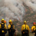 Firefighters watch the Bobcat Fire after an evacuation was ordered for the residents of Arcadia, California, U.S., September 13, 2020. REUTERS/Mario Anzuoni