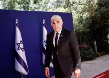 Israel's new Foreign Minister Yair Lapid arrives to a group photo of the newly sworn in Israeli government at the president's residence in Jerusalem on June 14, 2021. Photo by Yonatan Sindel/FLASH90 *** Local Caption *** ממשלת שינוי בית הנשיא יאיר לפיד שר החוץ